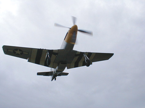 North American P51 Mustang with invasion stripes photo